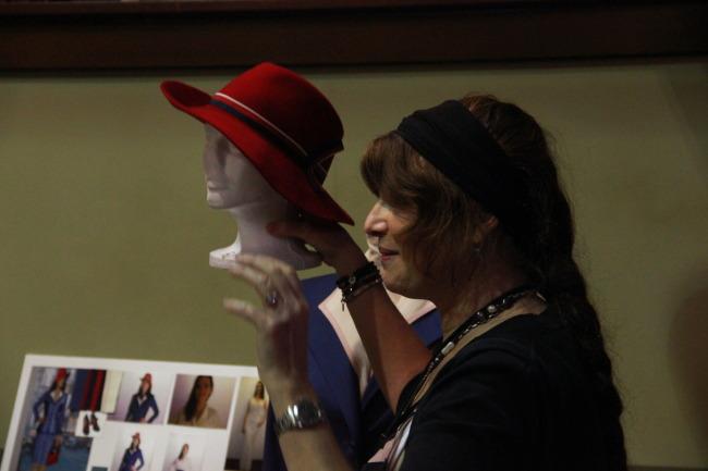 Gigi Melton holds red hat