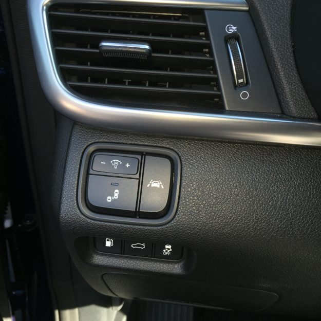 Easily access safety features on the driver's side panel