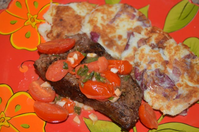 Pan-Seared Steak with Garlic Tomato Sauce and Crispy Parmesan Potato Cakes